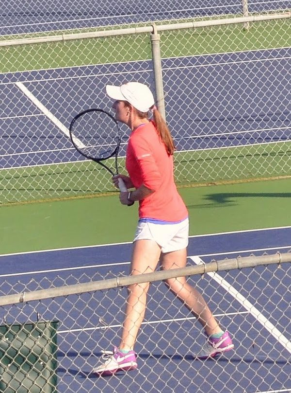 Girl Playing Doubles with a Wilson Tennis Racquet